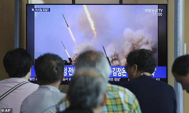 People watch a TV showing a news program reporting North Korea's missile launch, at the Seoul Railway Station in Seoul, South Korea, Sunday, May 5, 2019