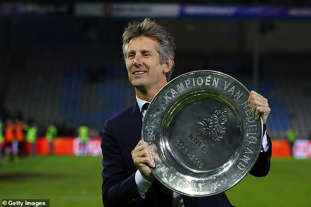 Ajax chief executive Edwin van der Sar posed with the league title to cap off a fine campaign
