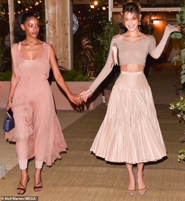 After the event Bella looked positively giddy walking hand-in-hand with her gal pal Fanny Bourdette Donon as they left the event