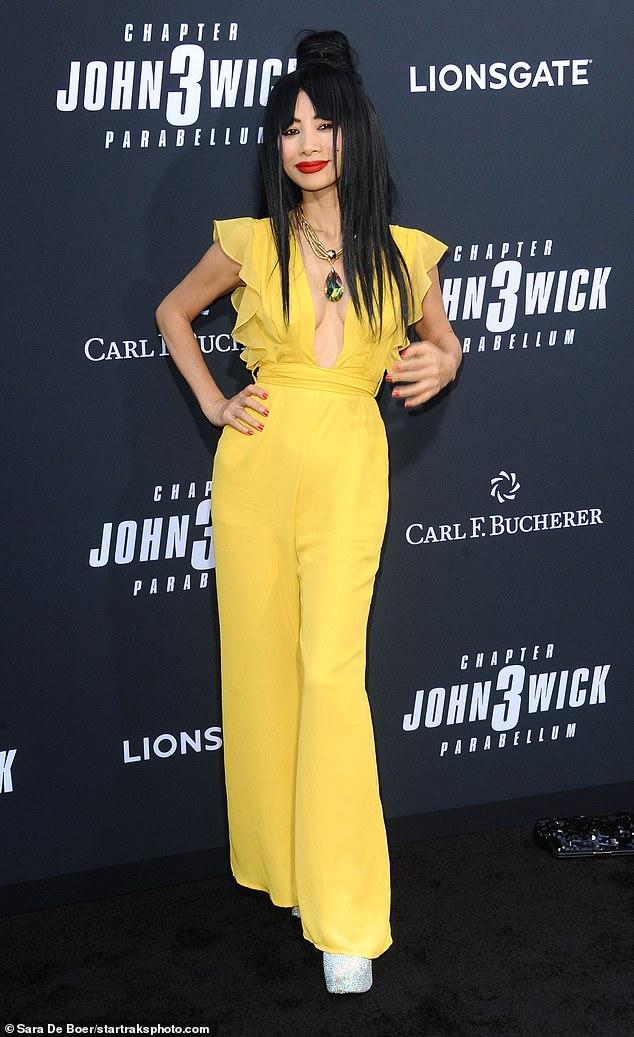 Bai smiles: Bai Ling rocks a yellow pantsuit