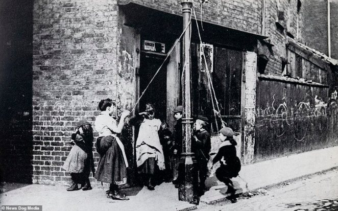 A street lamp becomes a maypole for these children in London in 1892. This is among the images taken by photographer Paul Martin, who was known to have had a fascination with the lower classes and capturing 'ordinary' people on camera