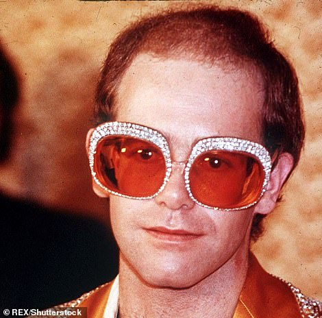 In the past: Elton showing off his unique sense of style in a similar look in 1976