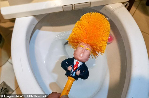 One user in Shanghai displays a toilet brush inspired by Donald Trump to a reporter yesterday