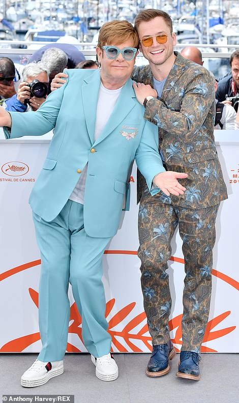 Gucci Gang: Elton (left) joined an equally flamboyantly dressed Taron ,(r(right) and Richard, at the Rocketman premiere at the Cannes Film Festival on Thursday