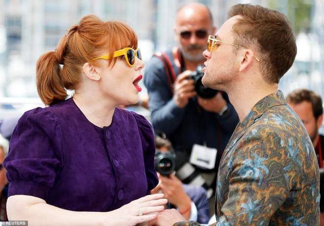 Snap happy: Bryce and Taron cooed over one another while surrounded by photographers