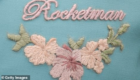 All in the details: Elton had Rocketman embroidered on his Gucci jacket lapel