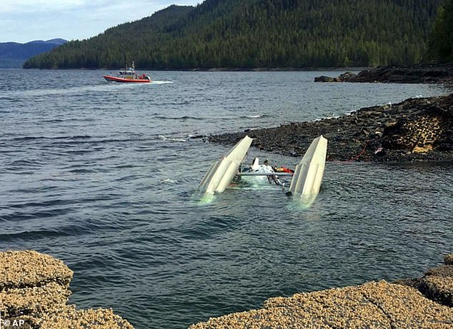 Six people were killed in the devastating crash including four Americans, a Canadian, and an Australian. One of the crashed sea planes pictured above in the George Inlet near Ketchikan, Alaska