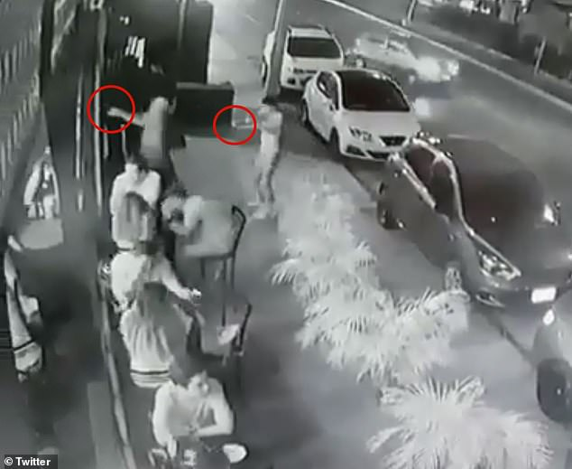 CCTV camera captures the frightening moment two men opened fired at restaurant patrons in the Mexican resort town of Playa del Carmen on Monday night
