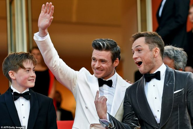The musical legend, 72, made sure he wore a rocket-themed suit for the once-in-a-lifetime event as he joined Taron Egerton, 29, who is playing him in the biopic of his life, and Richard Madden, 32, who plays his former lover and long-term manager, John Reid.