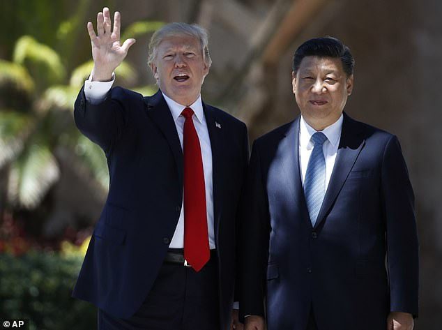 President Donald Trump and Chinese President Xi Jinping pause for photographs at Mar-a-Lago, Friday, April 7, 2017, in Palm Beach, Fla.