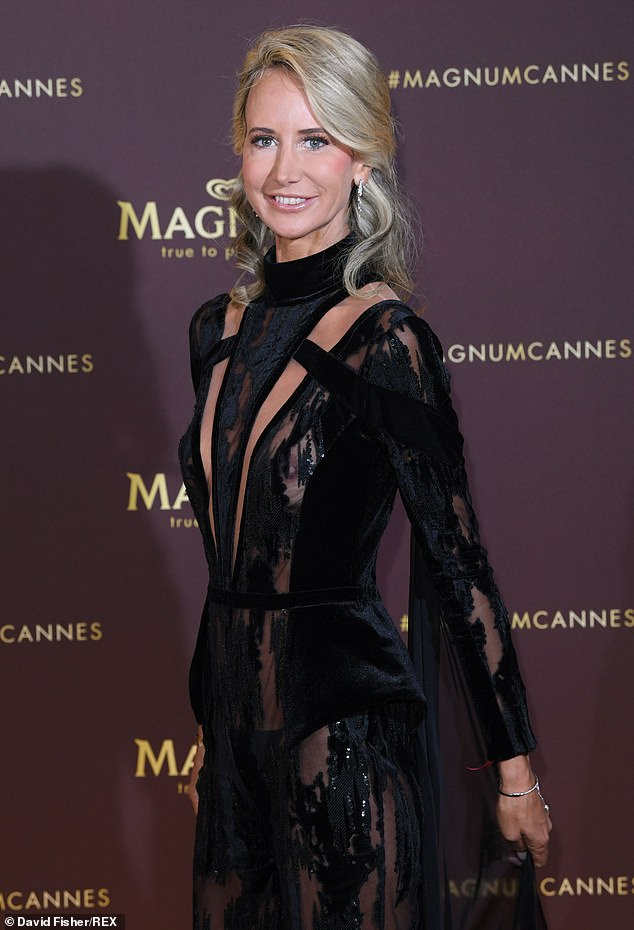 Dramatic: Lady Victoria Hervey turned up in a black gown, with sheer paneling, revealing her braless assets beneath