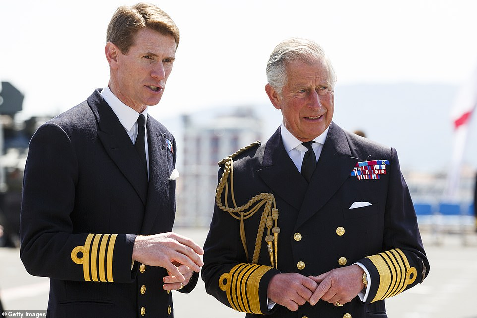 Captain Nick Cooke-Priest (pictured with Prince Charles) was fired over the 'misuse' of HMS Queen Elizabeth's official car