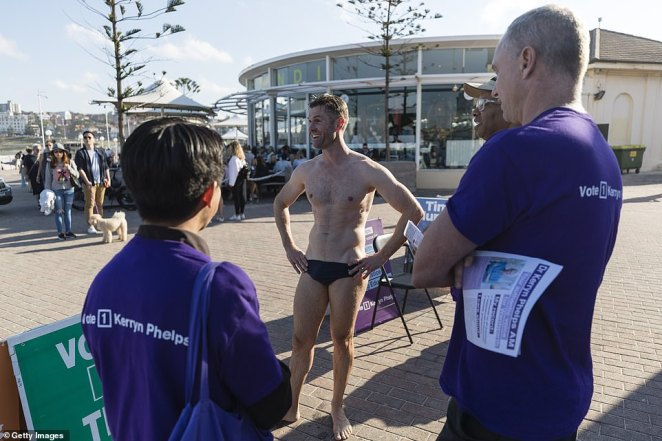A man in swim wear is pictured outside Bondi Surf Life Saving Club, in the seat of Wentworth, Sydney