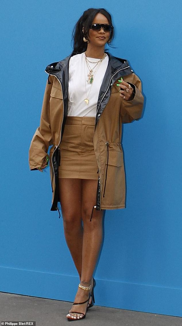 Sartorially-savvy: Rihanna looked effortlessly stylish in a khaki ensemble as she arrived at her Fenty store for the exclusive preview of her fashion line in Paris on Thursday