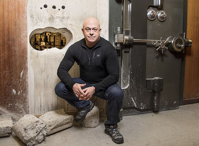 The former EastEnders actor who has forged a new career for himself in documentaries when behind the scenes of the raid at the central London safety deposit facility and is pictured by the hole drilled through a concrete wall into the vault
