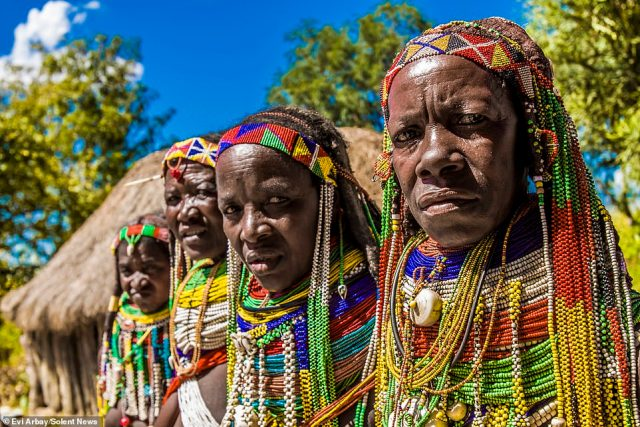 The Mwila tribe live in the sparsely populatedHuila province of southern Angola and are well-known for their elaborate styles of dress, their hair decoration, and necklaces