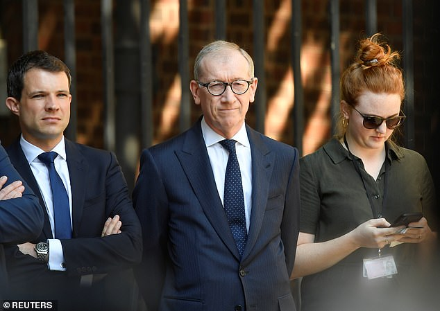 Philip May (pictured centre) looked as though he was suppressing an urge to comfort his wife as she made her speech. After her notorious coughing conference speech in 2017 he leapt on stage to embrace her at the end