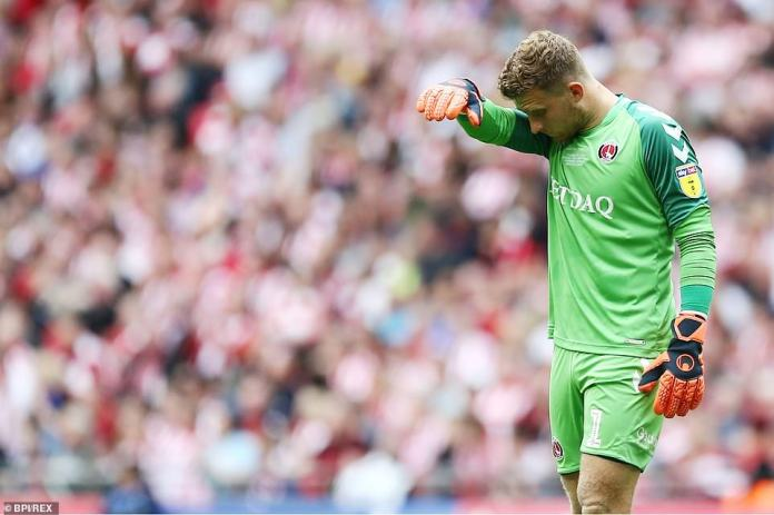 Charlton goalkeeper Dillon Phillips is dejected after allowing Mouhamadou-Naby Sarr's backpass to go under his foot