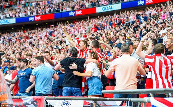 Sunderland supporters celebrate after Sarr's own goal gave them an early lead against Charlton at Wembley