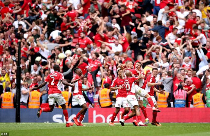 Charlton celebrate after securing a return to the Championship for the first time since 2016