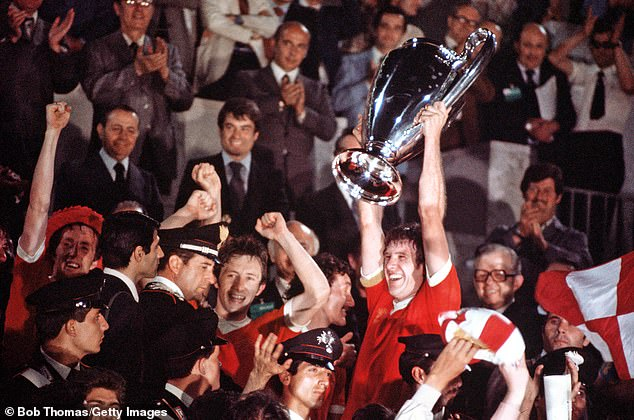 Emlyn Hughes is all smiles as he lifts the European Cup in 1977 at theStadio Olimpico in Rome