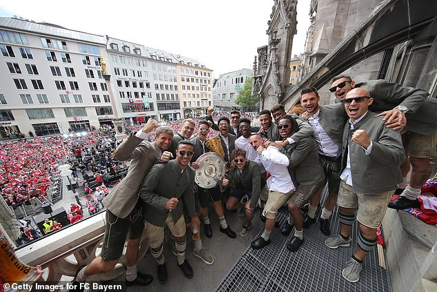 Dressed in traditional German attire, the players took to a podium in the famous Marienplatz