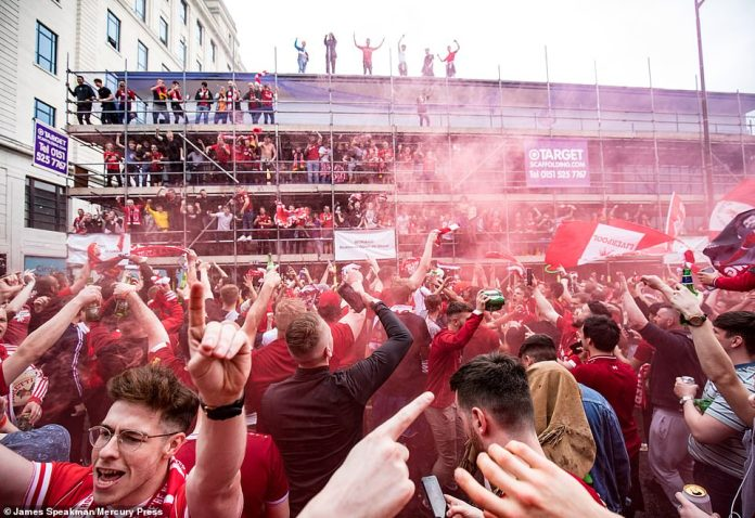 Hundreds of Liverpool supporters scale scaffolding outside Liverpool Central Station as they gear up to watch their side in a second Champions League final in two years
