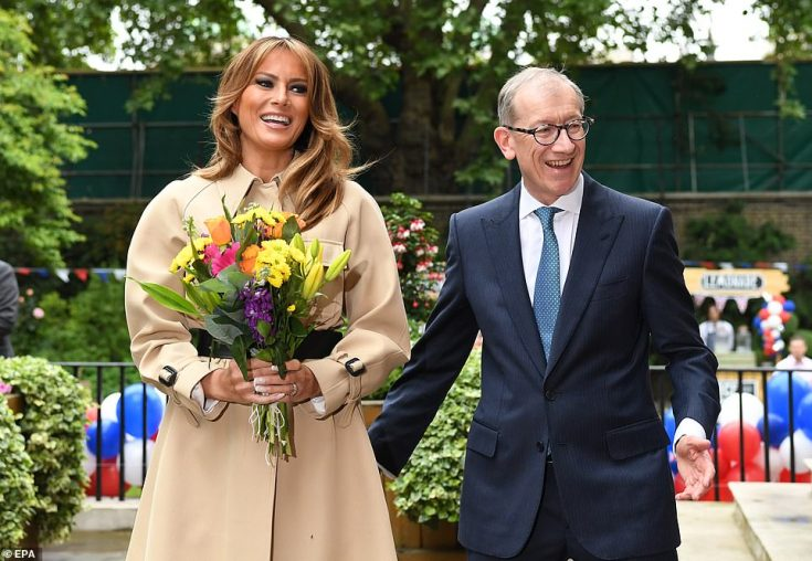 Melania looked happy to meet the children while her husband Donald Trump and Theresa May held talks inside Downing Street