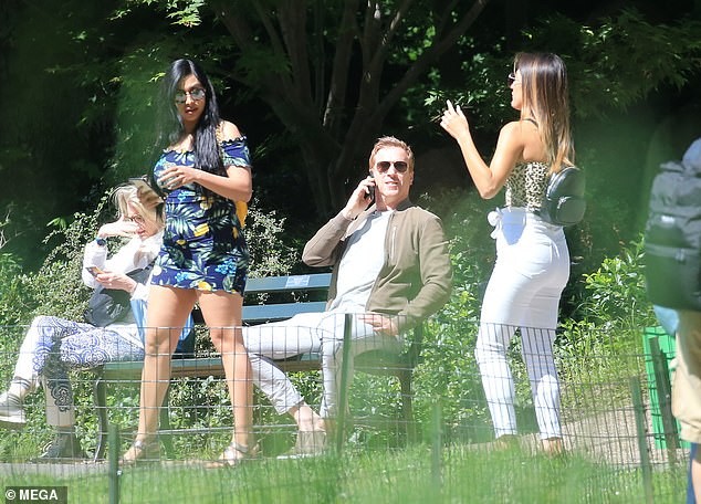 For the fans: Damian Lewis proved he was still down to earth despite his meteoric success as he happily posed with a gaggle of adoring female fans in NYC's Central Park on Monday