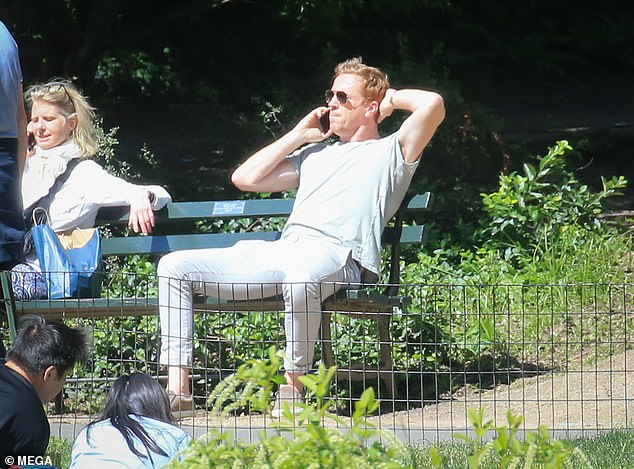 Kicking back:The Forsyte Saga actor looked typically hunky for his day in the sun, clad in a white tee, fawn jacket and stonewash skinny jeans