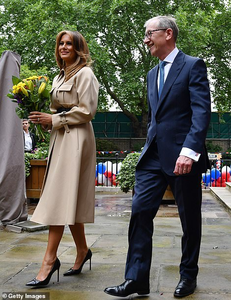 Philip May (left) and First Lady Melania Trump (pictured) attended a garden party