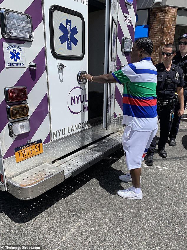 He was pictured walking into the back of an ambulance where he was checked over by doctors