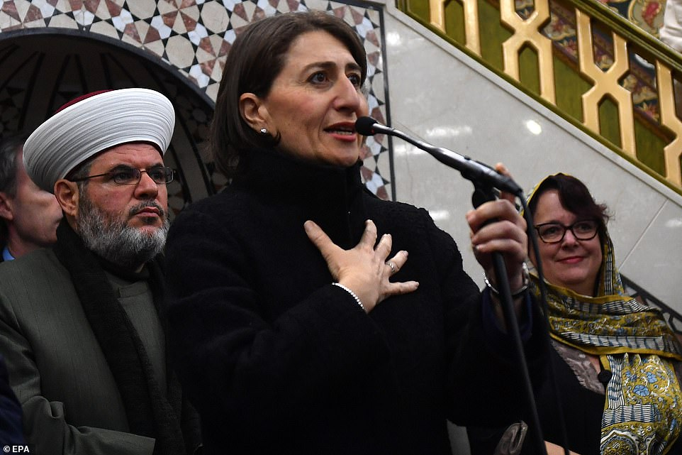New South Wales Premier Gladys Berejiklian (centre) speaks during a visit to the Muslim community celebrating Eid al-Fitr, marking the end of the month-long fast of Ramadan