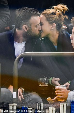 Lovebirds: Jennifer and Cooke spotted smooching at a hockey match in NYC in November