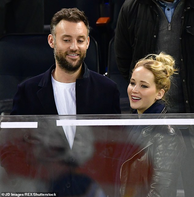 Tops: 'Well, he's just the best person I've ever met in my whole life,' Jennifer said of her beau, who steered clear of the red carpet; pictured together at Madison Square Garden in November