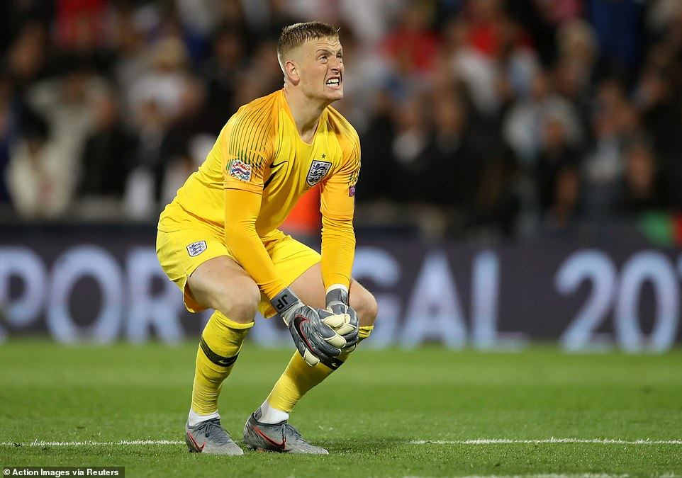 Pickford curses his luck after Holland take the lead in the first half of extra time with a lucky deflection off Walker
