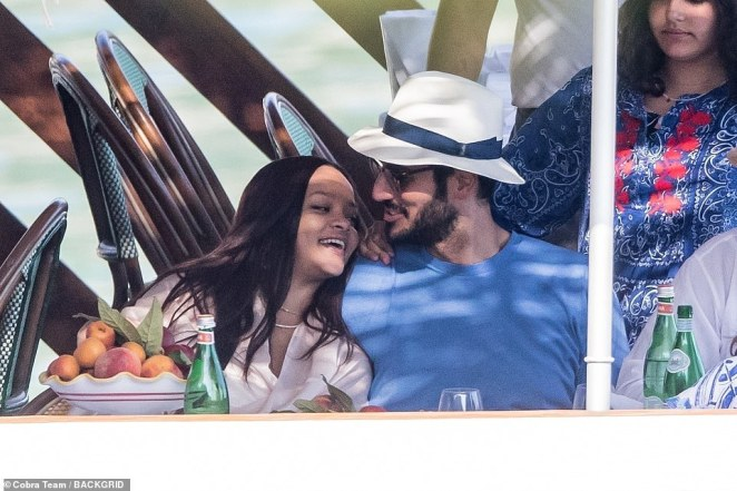 Couple: Rihanna , 31, enjoyed a sun-kissed holiday in Italy with her boyfriend Hassan Jameel, 30, on Thursday, with the couple cuddling up close whilst enjoying a romantic meal