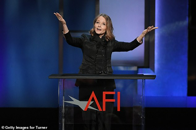 Center stage: Jodie raised her arms during her remarks