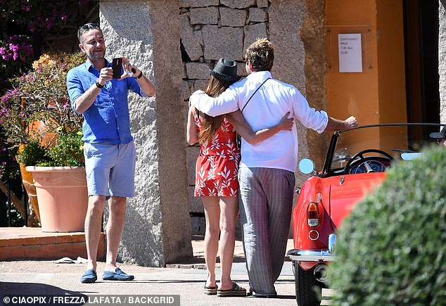 Famous: They were later spotted enjoying a low-key stroll and Jude even posed for fan photographs
