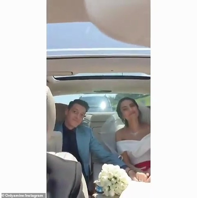Ozil (left) was photographed with his new wife Gulse (right) after the ceremony