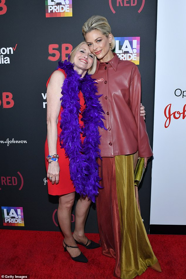 Contrasts: Whilst Jaime was in a floor-length golden gown and rust-colored leather jacket, Rita wore a sleek scarlet cocktail dress with a purple feather boa