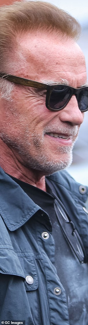 Spot the resemblance: Arnold is pictured out and about in Los Angeles this Thursday