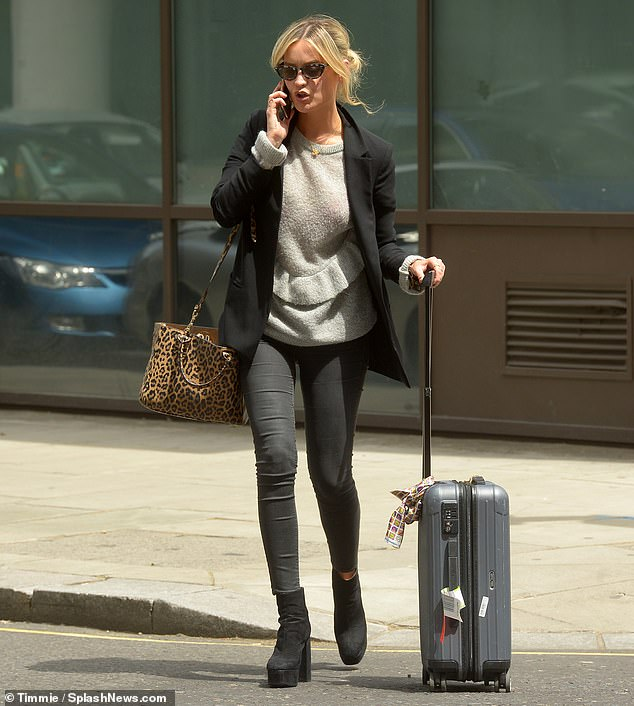 Here she comes: The bags were packed as Laura Whitmore left BBC Radio studios on Sunday afternoon, shortly after hosting her 5 Live show