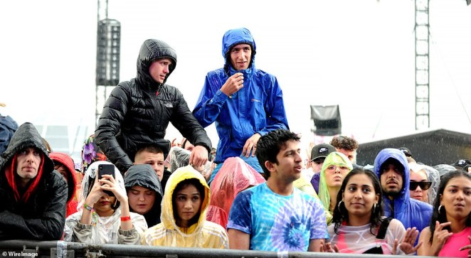 Music enthusiasts wear their colourful waterproof coats as they enjoy the music at the Parklife festival at Heaton Park on June 9