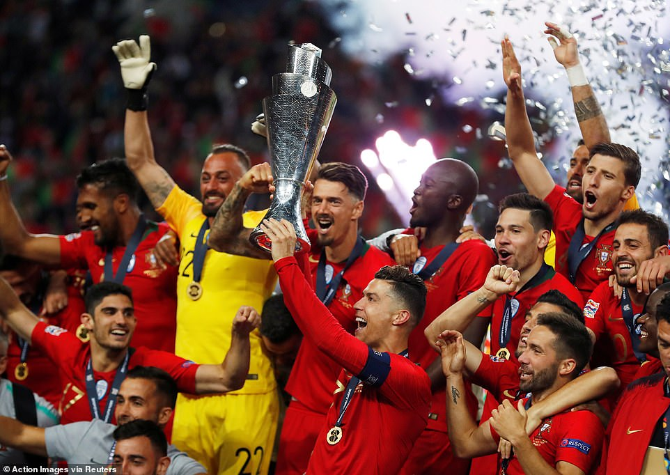 Cristiano Ronaldo hoisted the UEFA Nations League trophy aloft as the celebrations began for the hosts in Porto