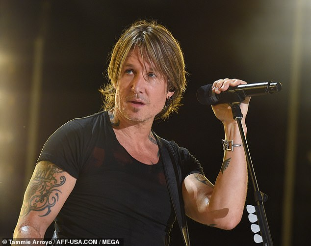 Lighting up the stage! Keith Urban stormed the stage as he performed at the CMA Music Festival in Nashville on Sunday