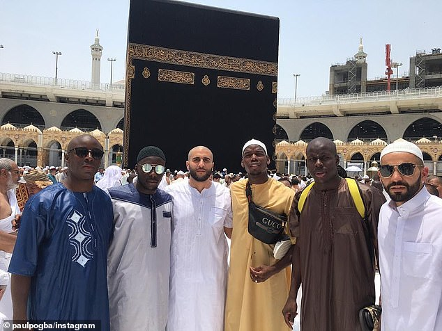 Pogba poses with Chelsea defender Zouma and a group of friends during their pilgrimage