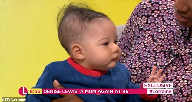 Relaxed: Troy looked incredibly cute in a cosy blue and red cardigan as he made his daytime TV debut