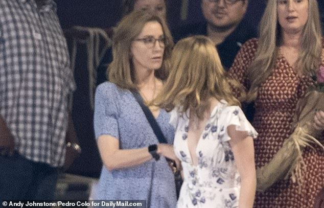 Turning heads: Sophia looks back towards her mother Felicity Huffman who has made a plea deal over the college scandal and will be recommended a prison sentence at the 'low end'