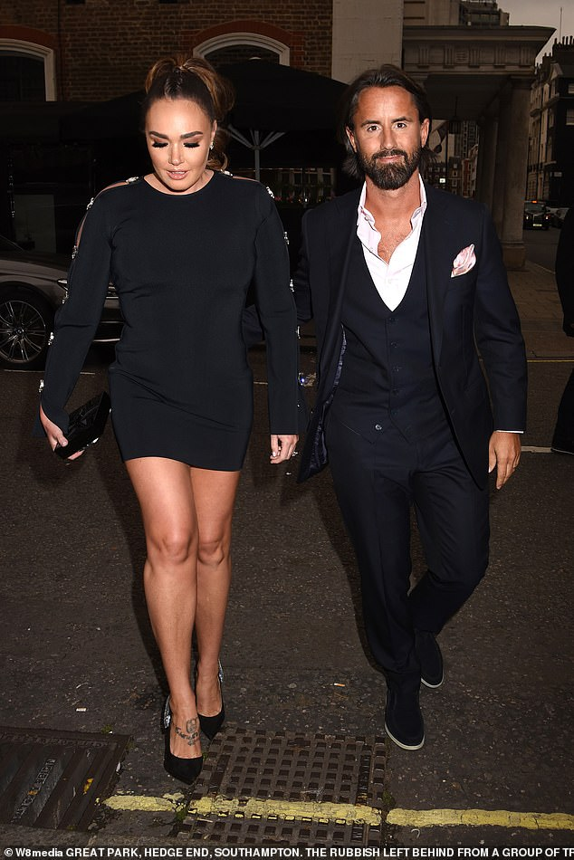 Fashionista: The billionaire heiress, 34, looked sensational as she slopped her figure into a clingy black jumper minidress